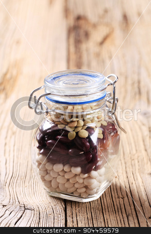Beans and lentils stock photo, Dry beans and lentils in a jar by Digifoodstock