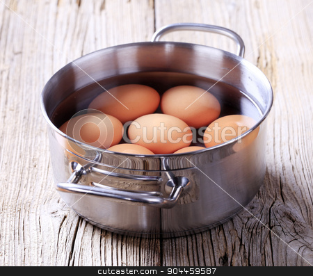 Brown eggs in a pan stock photo, Brown eggs in a pan - closeup by Digifoodstock
