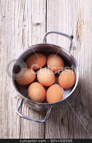 Brown eggs in a pan stock photo, Brown eggs in water in a pan by Digifoodstock