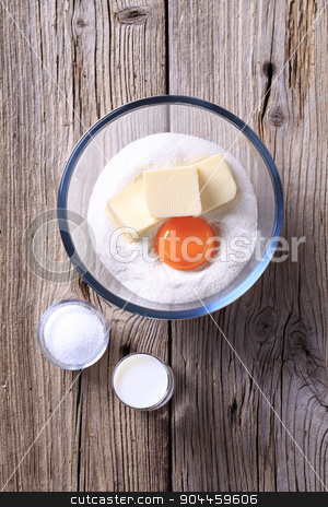 Ingredients to prepare pastry dough stock photo, Bowl of flour, egg yolk and butter by Digifoodstock
