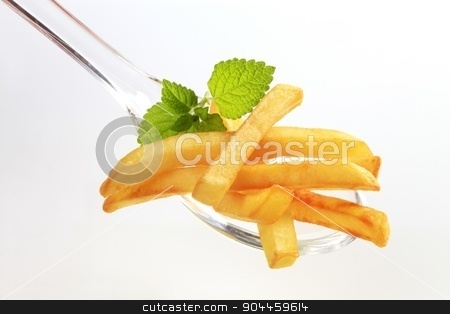 French fries  stock photo, French fries on a plastic spoon - detail by Digifoodstock