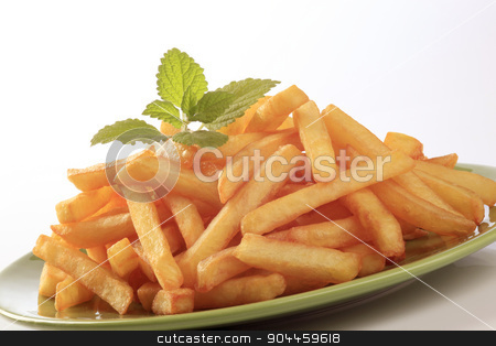 French fries  stock photo, Heap of French fries  on a green plate by Digifoodstock
