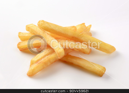 French fries  stock photo, Heap of French fries on white background by Digifoodstock