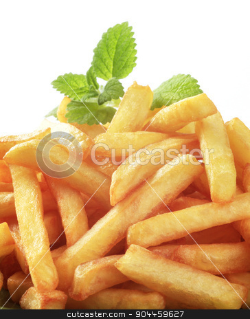 French fries stock photo, Heap of freshly fried French fries - detail by Digifoodstock