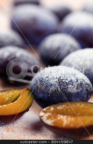 Ripe plums  stock photo, Ripe plums sprinkled with powdered sugar - detail by Digifoodstock