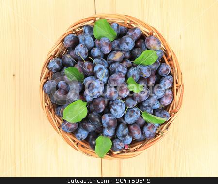 Basket of fresh plums stock photo, Freshly picked damson plums in a wicker basket by Digifoodstock