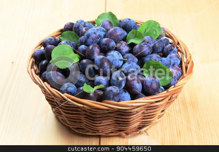 Fresh plums stock photo, Fresh plums in a wicker basket by Digifoodstock