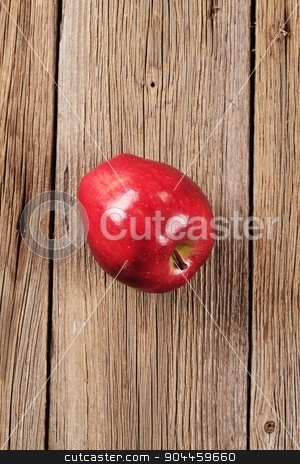 Red apple stock photo, Shiny red apple on wood - overhead by Digifoodstock