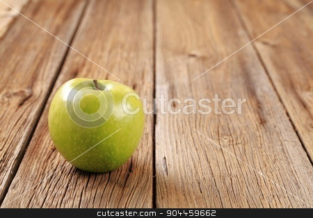 Green apple stock photo, Granny Smith green apple on wooden table by Digifoodstock