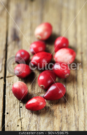 Cranberries stock photo, Group of fresh red cranberries on wood by Digifoodstock