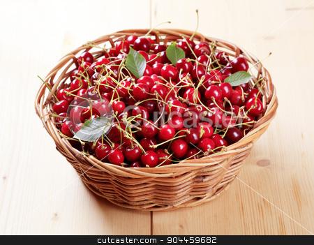 Basket of fresh red cherries  stock photo, Freshly picked red cherries in a basket by Digifoodstock