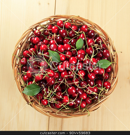 Basket of fresh red cherries  stock photo, Freshly picked red cherries in a basket by Digifoodstock