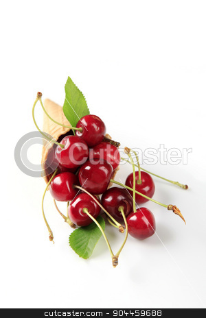 Fresh red cherries stock photo, Fresh red cherries in a wafer cone  by Digifoodstock