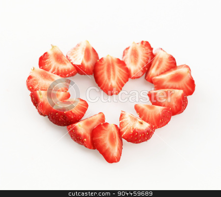 Strawberry heart stock photo, Wedges of fresh strawberries arranged in a heart shape by Digifoodstock