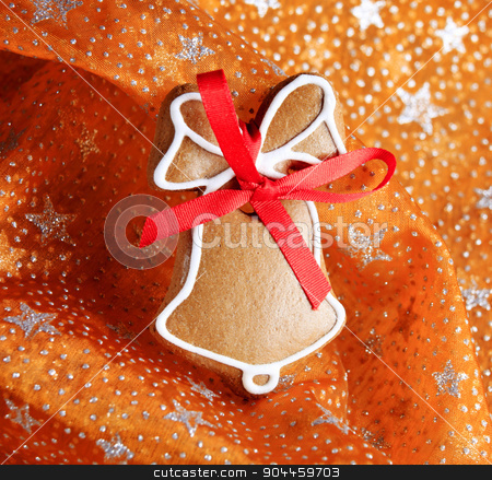 Gingerbread cookie  stock photo, Gingerbread cookie on a festive organza tablecloth by Digifoodstock