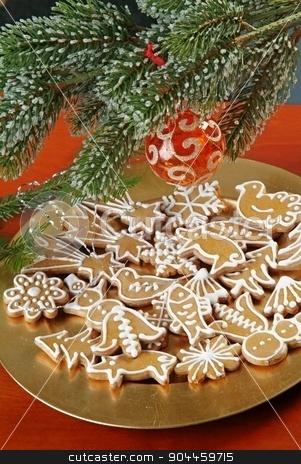 Christmas Gingerbread Cookies stock photo, Christmas gingerbread gookies  under evergreen branch by Digifoodstock