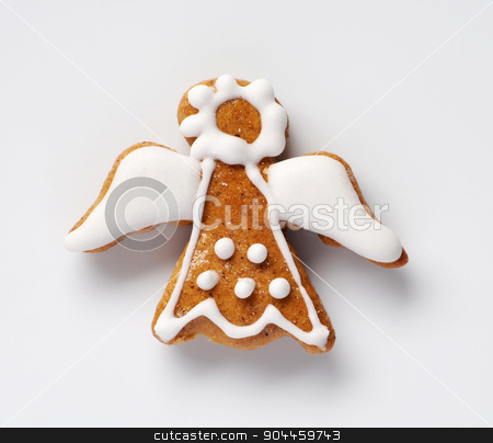 Gingerbread angel  stock photo, Gingerbread angel decorated with sugar icing - studio shot by Digifoodstock