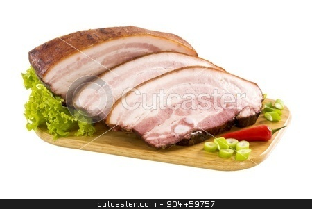 Slices of Slices of pork belly stock photo, Slices of pork belly on a cutting board by Digifoodstock
