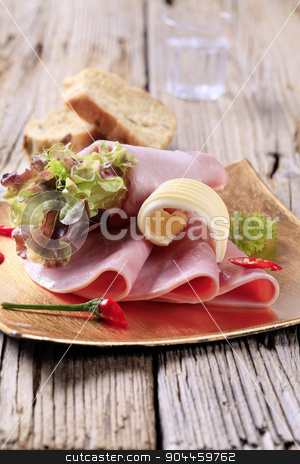 Sliced ham and bread stock photo, Thin slices of ham and salad greens by Digifoodstock