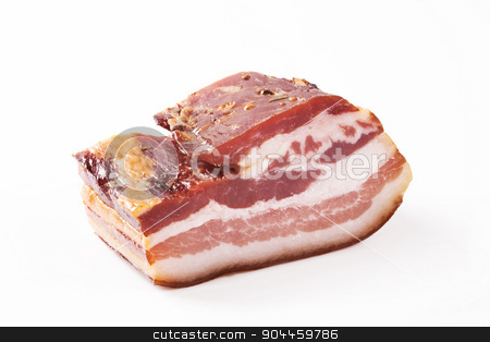Cured bacon stock photo, Closeup of cured bacon on white background by Digifoodstock