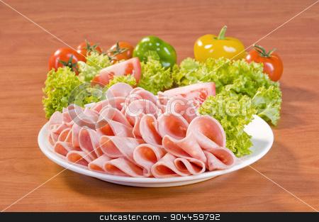 Slices of Mortadella salami  stock photo, Slices of Mortadella salami and fresh vegetable by Digifoodstock