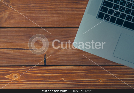 Laptop on the desk stock photo, Laptop keyboard on the brown wooden desk by kkolosov
