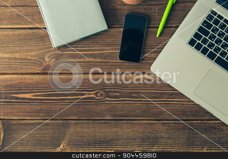 Laptop and diary on the desk stock photo, Laptop keyboard and diary on the brown wooden desk by kkolosov