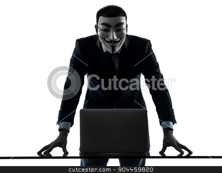 man masked anonymous group member computing computer silhouette  stock photo, Paris, France - October 30, 2012 : one man dressed and masked as a member of Anonymous underground group member computing computer on October 30, 2012 in Paris ,France by Ishadow
