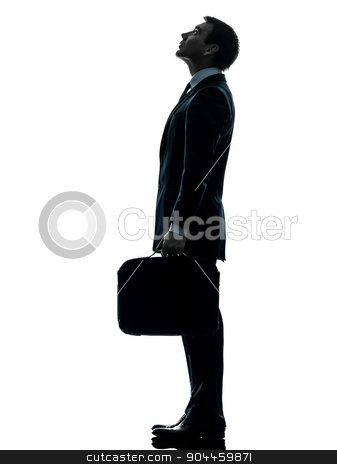business man standing looking up silhouette stock photo, one  businessman standing looking up profile in silhouette studio isolated on white background by Ishadow