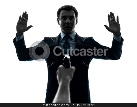 business man arms raised with gun pointing at him  silhouette stock photo, one  businessman arms raised with gun pointing at him in silhouette studio isolated on white background by Ishadow