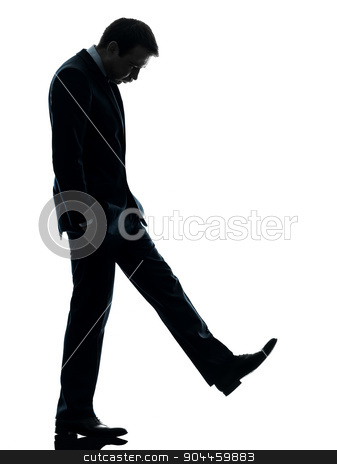 sad business man  looking down silhouette stock photo, one  sad business man looking down in silhouette studio isolated on white background by Ishadow