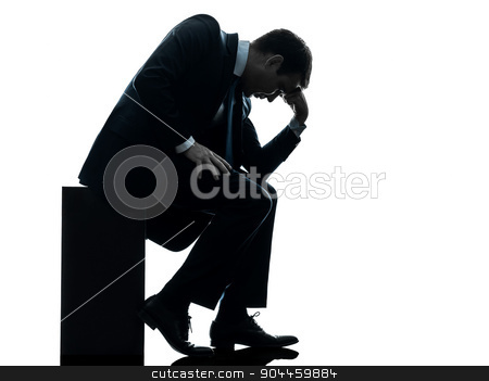 sad business man sitting pensive silhouette stock photo, one  sad business man sitting pensive looking down in silhouette studio isolated on white background by Ishadow