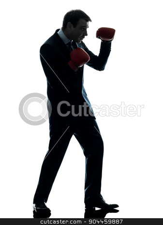 business man boxer with boxing gloves  silhouette stock photo, one  businessman with boxing gloves in silhouette studio isolated on white background by Ishadow