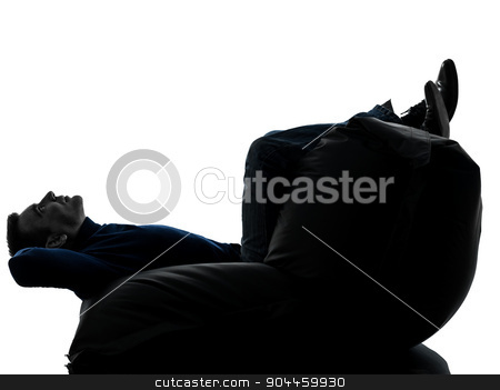 man sitting on bean bag silhouette full length stock photo, one  man sitting full length in silhouette studio on white background by Ishadow