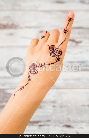 Woman Hand Painted with Floral Figures Using Black Henna  stock photo, Woman hand without nail polish painted with floral figures using black henna by OZMedia