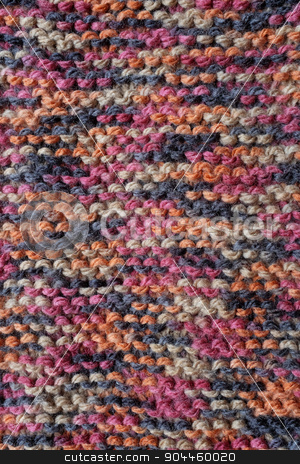 Length of knitting in multi-coloured yarn stock photo, Length of knitting in garter stitch with multi-colored wool as an abstract background texture by Sarah Marchant