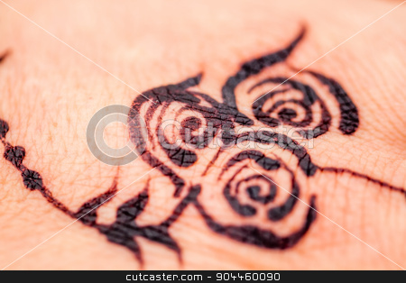 Close up of a Flower Design Painted with Black Henna to the Skin stock photo, Close up of a flower design painted with black henna to the skin by OZMedia