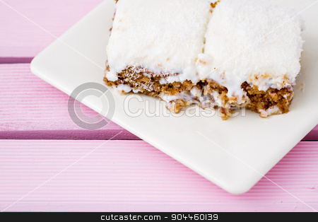 Slice of Delicious White Cream Cake on White Plate stock photo, Slice of delicious white cream cake on white plate by OZMedia