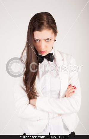 Angry businesswoman stock photo, Angry business lady in white suit with crossed hands by Aikon