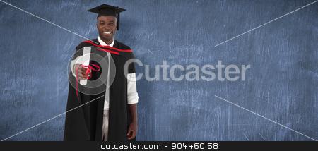 Composite image of man smilling at graduation stock photo, Man smilling at graduation against blue chalkboard by Wavebreak Media