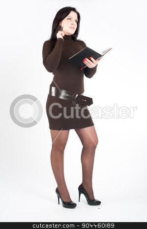 Beautiful business lady stock photo, Attractive young businesswoman standing with diary log by Aikon