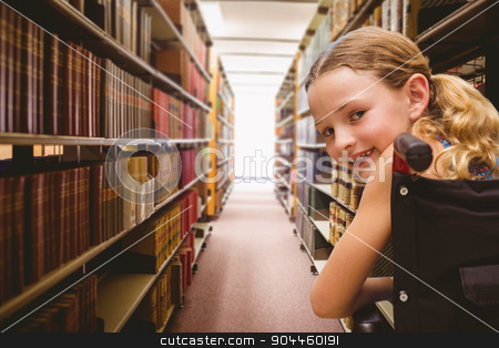 Composite image of portrait of cute girl sitting in wheelchair stock photo, Portrait of cute girl sitting in wheelchair against close up of a bookshelf by Wavebreak Media