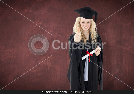 Composite image of teenage girl celebrating graduation with thum stock photo, Teenage Girl Celebrating Graduation with thumbs up against desk by Wavebreak Media
