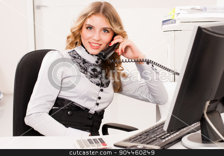 Young businesswoman stock photo, Young business woman sitting in front of computer monitor in office by Aikon
