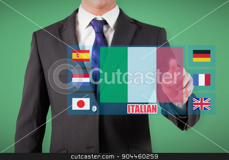 Composite image of businessman standing and pointing stock photo, Businessman standing and pointing against green by Wavebreak Media