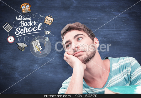 Composite image of student daydreaming stock photo, Student daydreaming against blue chalkboard by Wavebreak Media
