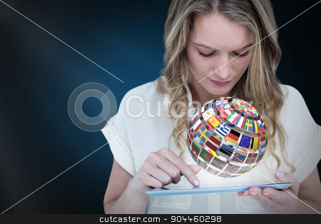 Composite image of woman using tablet pc  stock photo, Woman using tablet pc  against blue background with vignette by Wavebreak Media
