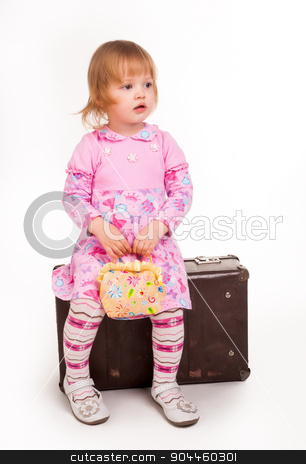 portrait of adorable young girl on old suitcase stock photo, Full length portrait of a little 2 years old girl sitting on suitcase at white background by Aikon