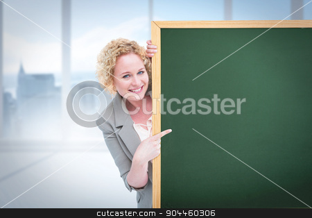 Composite image of woman showing card stock photo, Woman showing card against bright white room with windows by Wavebreak Media