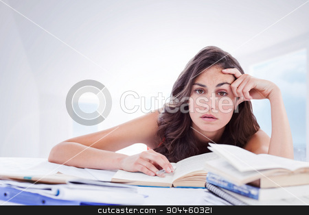 Composite image of bored student doing her homework stock photo, Bored student doing her homework against bright white hall with columns by Wavebreak Media